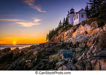 Bass Harbor Lighthouse at sunset, in Acadia National Park,...