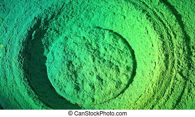 Bass loudspeaker throws green powder in the air, super slow motion shot