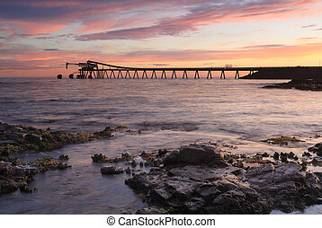 Bass Point Cargo Loader Pier at Sunrise - The 400 metre long...