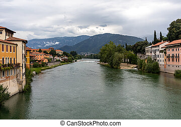 Colorful Houses and Brenta river in Bassano del Grappa. ...