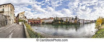 Cityscape of Bassano del Grappa with river Brenta and bridge Ponte degli Alpini in Vicenza, Italy