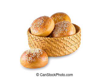 Bast-basket with buns is photographed on the white ...