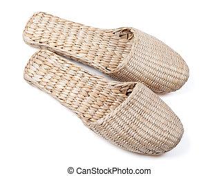 Bast shoes on white background