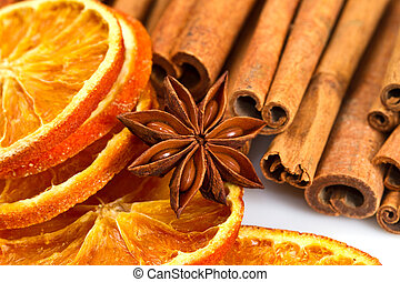 bastoncini di cannella, anice stella, e, secco, arancia,...