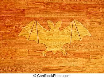 Bat icon on wood background