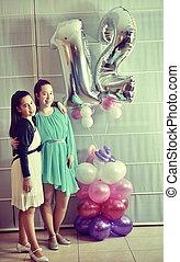 Secular 12-year-old Israeli teenager celebrating her Bat Mitzvah with her older sister (vintage-processed)