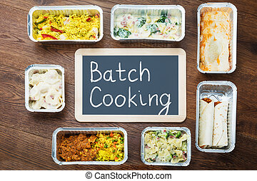 Batch Cooking Text Written On Slate With Take Away Dishes