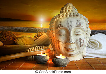 Bath accessories with buddha statue at sunset