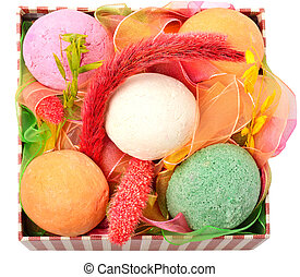 Bath bombs with decor in the box isolated on white