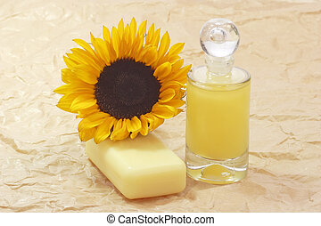 Bath lotion with sunflower on brown background