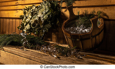 Bath Russian brooms birch, oak branches and leaves, bucket with water and ice