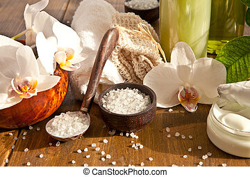 Bath salts and other skin care products  with fresh orchids
