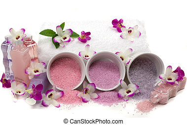 Different kinds of crystal bath salts, lotions, massage oils, towel, mint, exotic orchids and mint