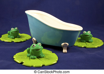 Bath scene with blue bathtub and green froggies on lily pads against blue background