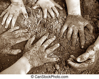 Bath Time 2 - Three pairs of small hands in a pile of dirt.