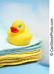 Bath Time - A rubber ducky and other bathing items come...