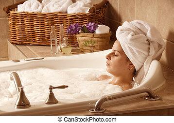 Bath time - cute girl with a towel on her head in a bath