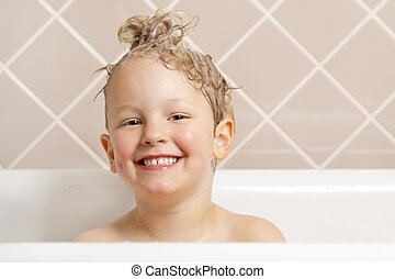 Bath time. - A gorgeous young boy has fun in the bath.