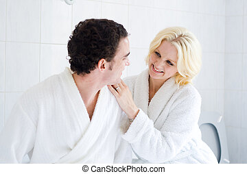 bath time - young couple in bathroom, bath time concept