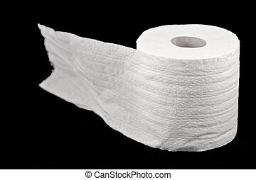 Roll of toilet paper on the black background