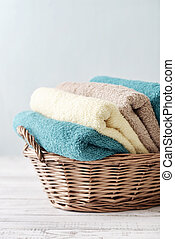 Bath towels in wicker basket - Bath towels of different...