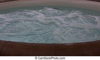 Bath tub full of bubbling water