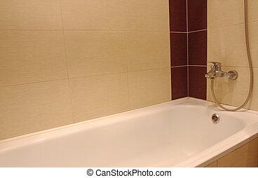 Bath tub with chrome faucet.