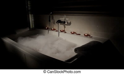 Bath with foam and scented candles