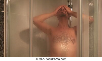 bathing - middle age brunette man taking a shower