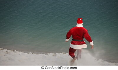 Bathing Santa - Santa Claus jumping into the water and...