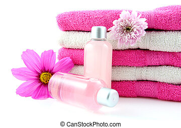 Bathroom and spa accessory with towels isolated on white background