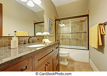 Bathroom cabinet with drawers and granite top.