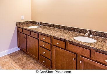 Bathroom Cabinets with Granite Vanity and Tile Floor