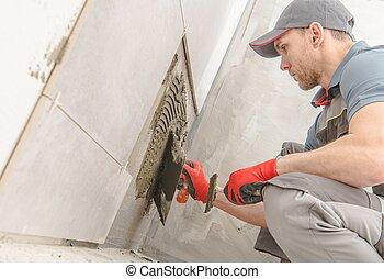 Bathroom Ceramic Tiles Installer. Caucasian Construction...