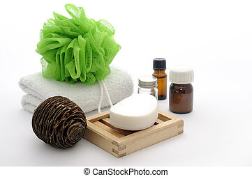 Bathroom composition with soap, essiantil oil, towel, soap dish, sponge isolated on a white.