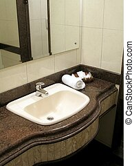 Bathroom counter - A modern hotel bathroom counter with...