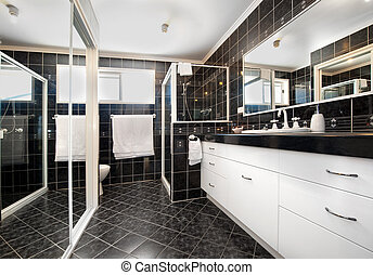 Black tiled bathroom with white trimmings