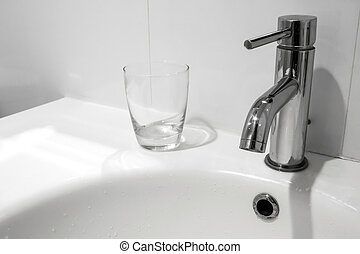 Bathroom faucet and wash basin with water glass - White...