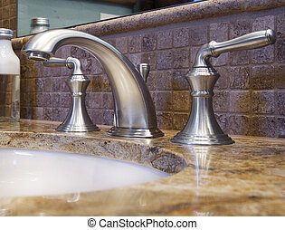 Bathroom Faucet - Extreme closeup of bathroom faucet