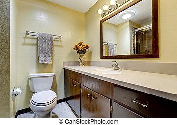 Bathroom in brown color with beige walls