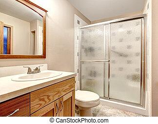 Bathroom interior. Glass door shower