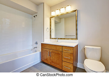 Bathroom interior in white tones and vanity cabinet.