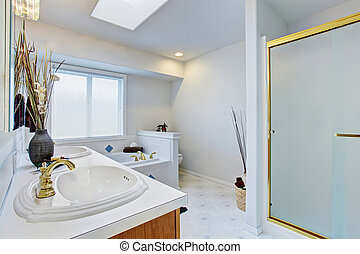 Bathroom interior in white tones with brown cabinets