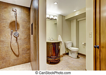 Bathroom interior with carved wood vanity cabinet