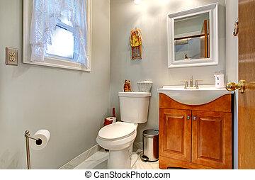 Bathroom interior with new vanity cabinet and mirror