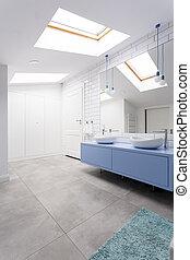 Bathroom on attic with window