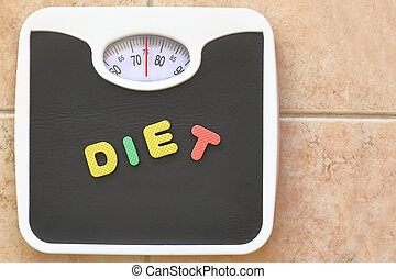 Bathroom scale with Diet text. Diet concept