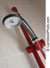 White bathroom with red and chrome shower