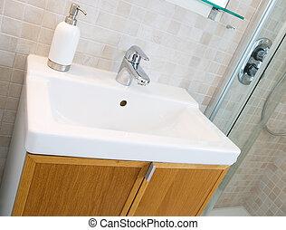 Bathroom Sink - A standard new bathroom sink with tiles on...