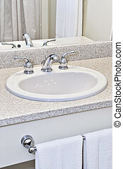 Bathroom sink - Bathroom interior with white sink, faucet...